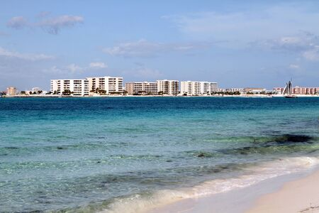 View of Destin beaches filled with condominiums from across the clear blue waters of Destin pass. Stock Photo - 15205765