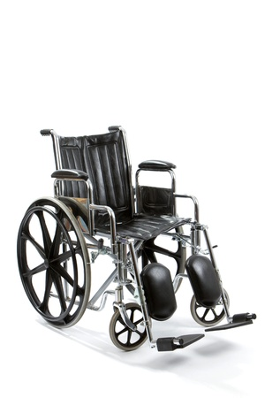 senile: Empty black and chrome wheelchair sits vacant on white background.