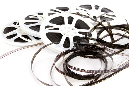 Obsolete rolls of old 8mm movie film are wound on white plastic reels
