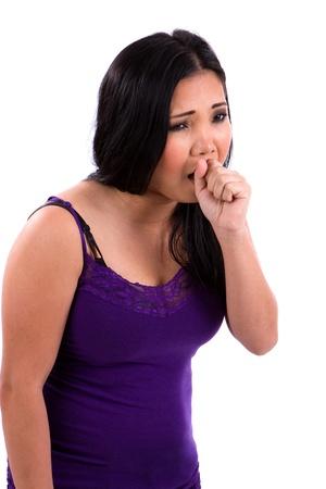 tosiendo: Adolescente asiático enfermo con un resfriado y la gripe tose en su puño.