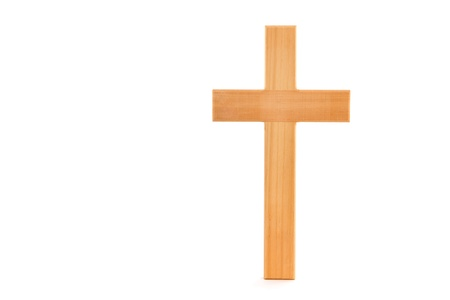 Wooden cross with grain standing on a white background