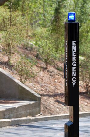 Emergency distress beacon with help call box located in public park