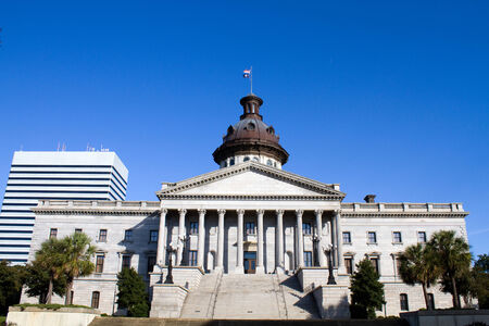 Capital building in Columbia, South Carolina with modern city building in the background. Stock Photo - 24075401