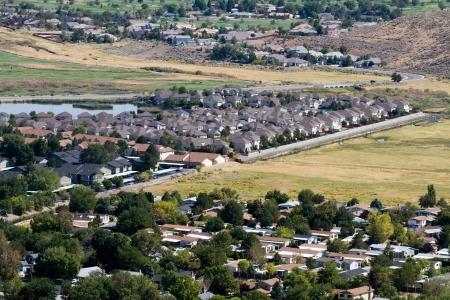 Aerial view of suburban neighborhoods as developments sprawl out into surrounding open areas in Reno, Nevada, USA  photo