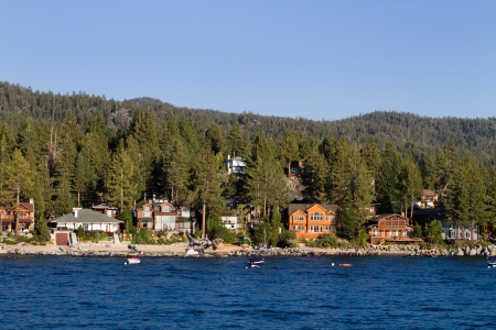 Waterfront homes among the pine trees along the shoreline of Lake Tahoe, Nevada, USA Stock Photo - 24753159
