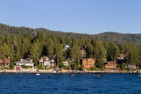 Waterfront homes among the pine trees along the shoreline of Lake Tahoe, Nevada, USA Stock Photo - 24753159