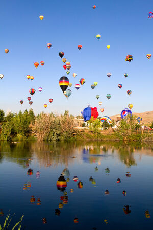 RENO, NEVADA, USA - SEPTEMBER 6, 2013: The Great Reno Balloon Race on September 6, 2013 in Reno, Nevada, USA. The early morning mass ascension of dozens of hot-air balloons draws thousands of tourists to the area as the sky fills with balloons in what is