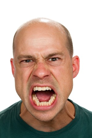 insane insanity: Angry and mad man screams with his mouth wide open showing his rage. Stock Photo