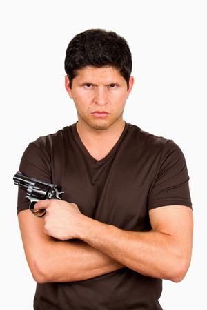 menacing: Serious and menacing looking gang member holds a gun.