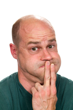 nauseous: Sickened man holds his mouth closed as he is about to vomit and throw up. Stock Photo