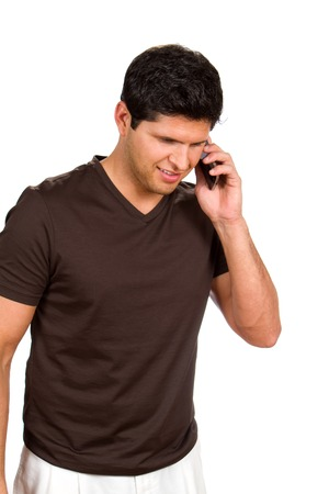 Young man talks on his cellphone against white background. Stock Photo