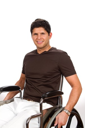 paraplegic: Successful disabled man sits in his wheelchair smiling.