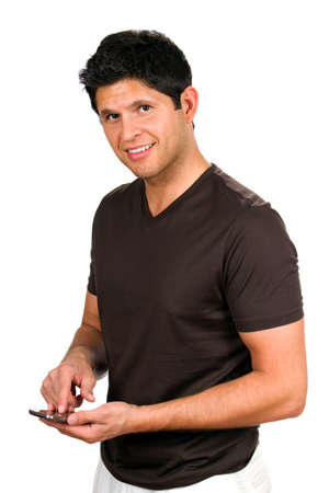 latin man: Happy man smiles as he sends a texting message on his smartphone.