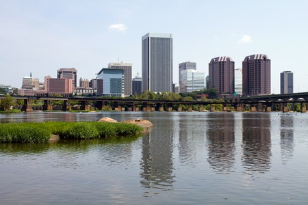 A skyline view of Richmond, Virginia, USA, the state capital, as seen from across the James River.