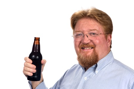 Mature smiling man holds a bottled of beer. Stock Photo