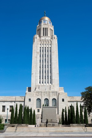gold capped: The tower of the Nebraska State Capitol building is 15 stories tall and is capped with a gold tiled dome. It is located in Lincoln, Nebraska, USA.