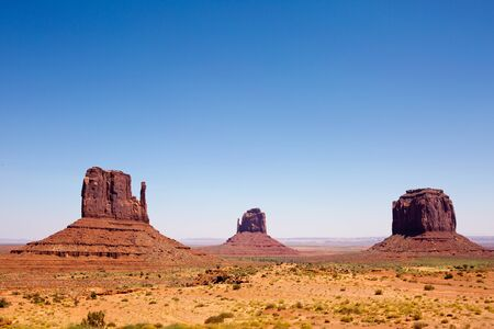 mesas: Visitors off in the distance view the mesas of Monument Valley Navajo Tribal Park in southern Utah, USA.