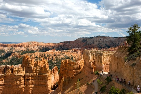 sightseers: BRYCE CANYON NATIONAL PARK, UTAH, USA - AUGUST 16, 2015: Tourists climb the trails as they view the hoodoos in Bryce Canyon National Park located in southern Utah, USA, on August 16, 2015. Editorial