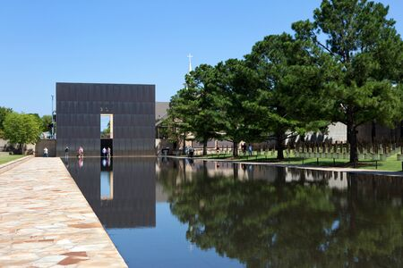 bombings: Oklahoma City, Oklahoma, USA - AUGUST 6, 2015: Visitors walk the grounds at the Oklahoma City National Memorial, OK, on August 6, 2015.