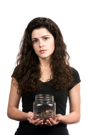 inadequate: Young woman holds a jar of money with a questioning look on her face to portray a inadequate savings concept. Stock Photo