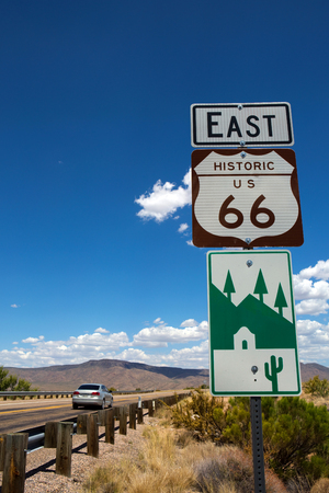 Car travels along the highway east on Historic US Route 66 in northwestern Arizona, USA.