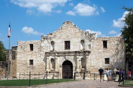 SAN ANTONIO, TEXAS - AUGUST 22, 2015: Tourists line up to visit The Alamo in San Antonio, Texas, USA, on August 22, 2015.