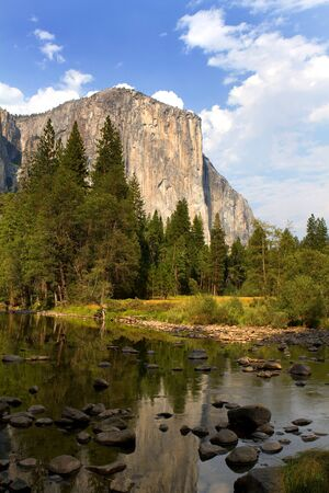 El Capitan viewed from across the Merced River in the valley floor of Yosemite National Park, California, USA.
