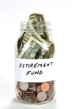 Cash money from a retirement fund is in a glass jar.