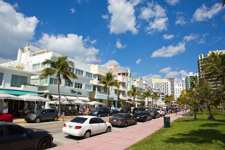 MIAMI BEACH, FLORIDA - FEBRUARY 15, 2017: Tourists stroll along famous Ocean Drive which runs parallel to Southbeach in Miami Beach, Florida, USA on February 15, 2017.