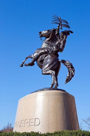 Tallahassee: TALLAHASSEE, FLORIDA - FEBRUARY 11, 2017: The Unconquered statue of a Seminole Indian riding a horse is outside Doak S. Campbell Stadium on the campus of Florida State University in Tallahassee, Florida on February 11, 2017.