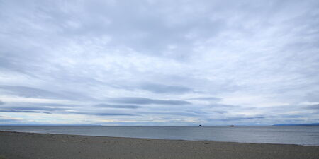 punta arenas: View over the ocean (the Magellan Strait) from Punta Arenas, Chile, with large Patagonian skys overhead.