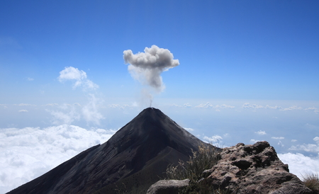Volcan Fuego (Fire volcano) erupts a cloud of ash and smoke near Antigua, Guatemala. 스톡 콘텐츠