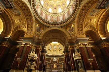 Ornate architecture, arches, domes, and golden decoration in the interior of St. Stephens Basilica in Budapest, Hungary