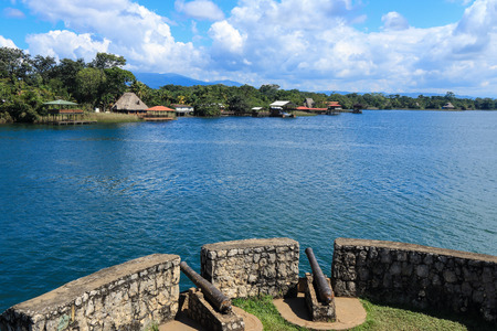 View from Castillo de San Felipe de Lara, looking out over Lago Izabal. Castillo de San Felipe is a fort located at the entrance to Lago Izabal in Rio Dulce, Guatemala. It was built by the Spanish in 1644. Stock Photo - 34879444