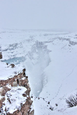 The famous Gulfoss waterfall, surrounded by a snow covered landscape in the middle of winter. Iceland. photo