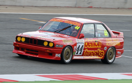 british touring car: BMW M3 being driven in the British Touring Car race at an historic race meeting.