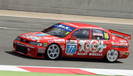 british touring car: Nissan Primera being driven in the British Touring Car race at an historic race meeting.