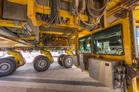 beneath: Standing beneath the 17 ton yellow Otto vehicle used to transport the radio telescopes at the ALMA Atacama Large Millimetersubmillimeter Array Operations Support Facility OSF.