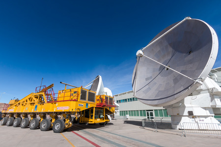 alma: One of ALMAs 66 radio telescopes at the OSF ready for maintenance. The yellow vehicles weigh 17 tons and are used to transport the telescopes between the OSF at 3200 metres and the array at 5000 metres. Atacama Large Millimetersubmillimeter Array.