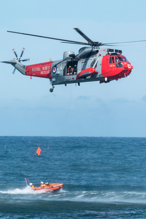 rescuing: The Royal Navys Sea King search and rescue helicopter demonstrates rescuing a person from a small boat during the 2015 Sunderland air show.