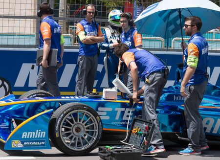 Simona de Silvestro's Andretti Formula E car is prepared on the grid before the start of the 2015 Formula E ePrix in Putrajaya, Malaysia.