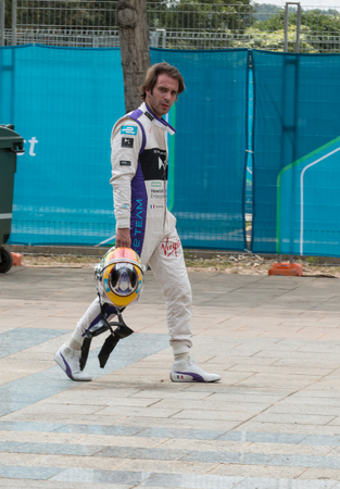 nick: Nick Heidfeld Mahrinda Racing team walks back to the pits after a first-lap collision forced his retirement from the 2015 Formula E ePrix in Putrajaya, Malaysia.