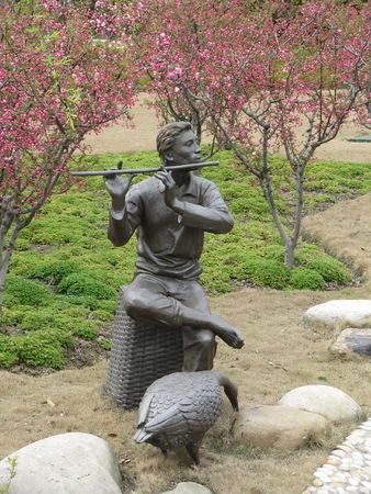 fluent: fluent player statue and peach flower in spring