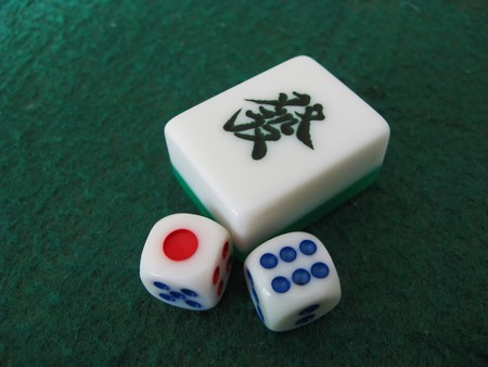 mahjong tile of rich and dice on gamble table photo