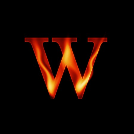 fire letter W isolated on dark background photo