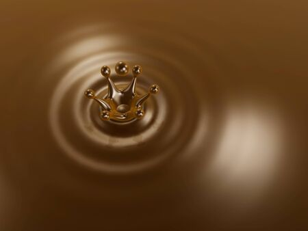 Chocolate liquid drop crown and ripple background