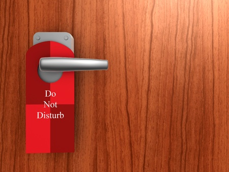 hotel door: do not disturb sign on hotel door handle Stock Photo
