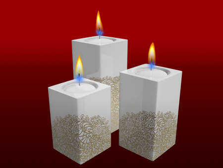 white candles with golden floral pattern of christmas on red background photo