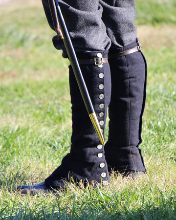 gaiters: 1800s military soldier with saber, gaiters and boots Stock Photo