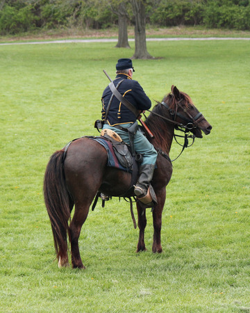 Civil War reenactment with Union Soldier and horse Stock Photo